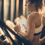 girl working out on treadmill