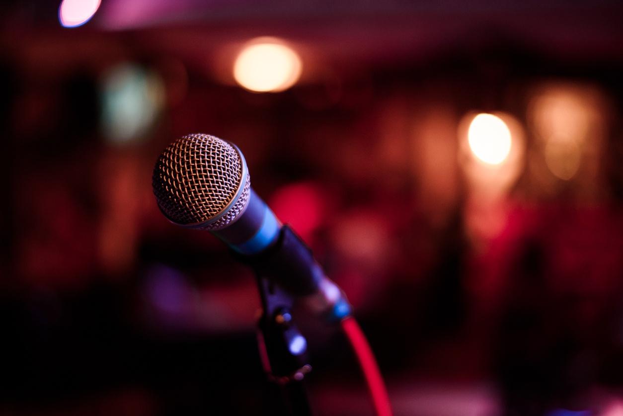 shallow-focus-picture-of-microphone-at-music-venue
