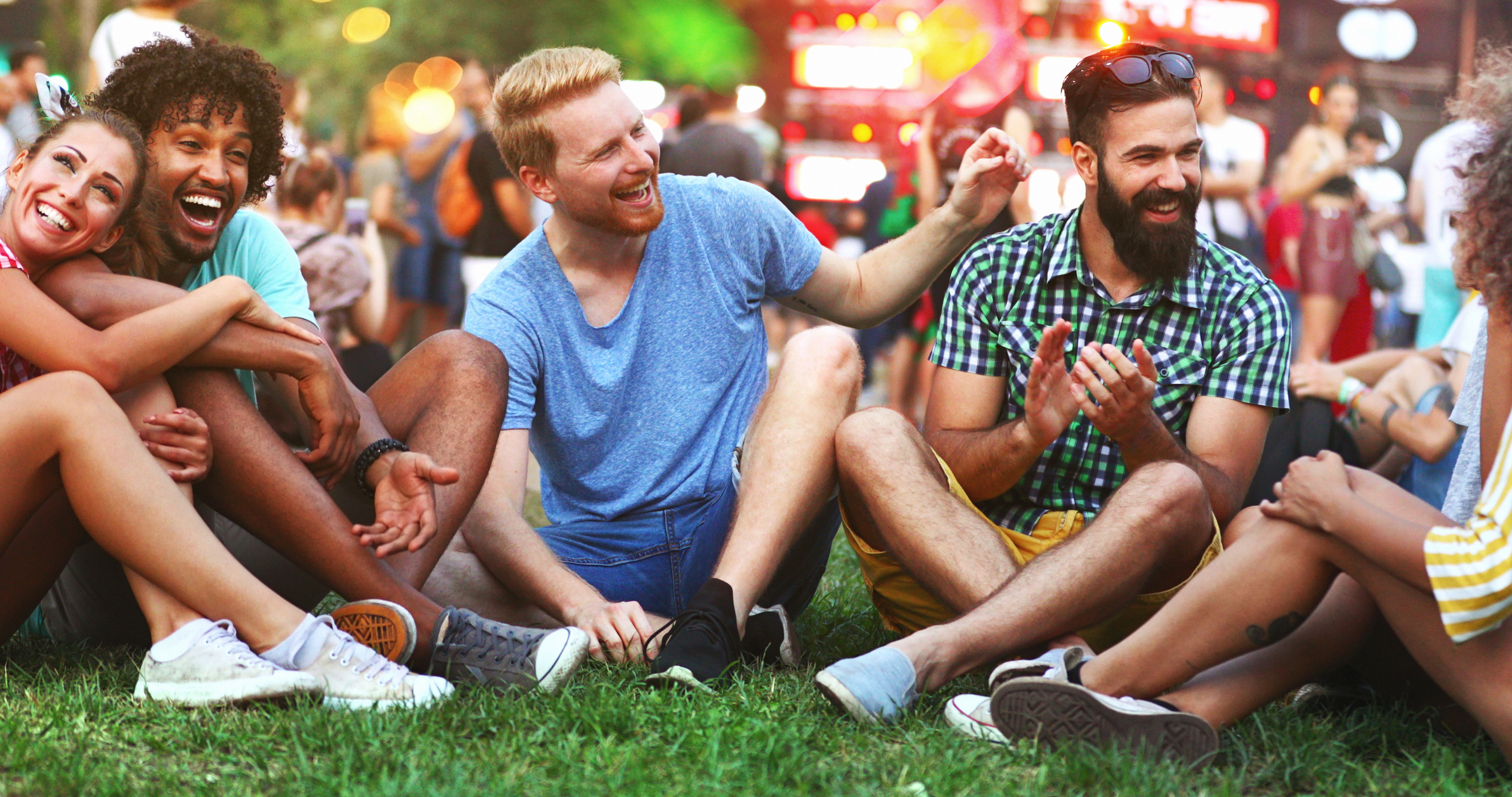 friends gather on grass before event