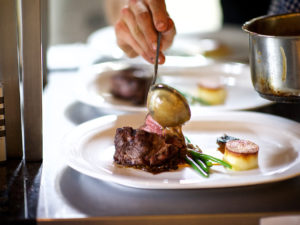 chef plating gourmet steak