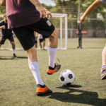 a group of people playing soccer outside | Houston's adult sports leagues